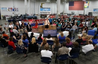 Republican presidential candidate Rep. Michele Bachmann (R-MN) (C) at Competitive Edge, an advertising and promotion product manufacturer, August 10, 2011; one of the many stops she's made all over Iowa before the straw poll Saturday.