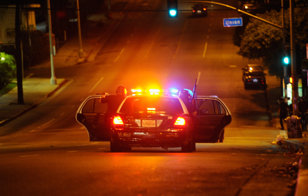 Officers from the Los Angeles Police Department patrol the streets after objects following protests, on September 7, 2010 in Los Angeles, California.