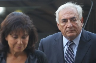 Former International Monetary Fund (IMF) director Dominique Strauss-Kahn enters Manhattan State Supreme Court with his wife Anne Sinclair.
