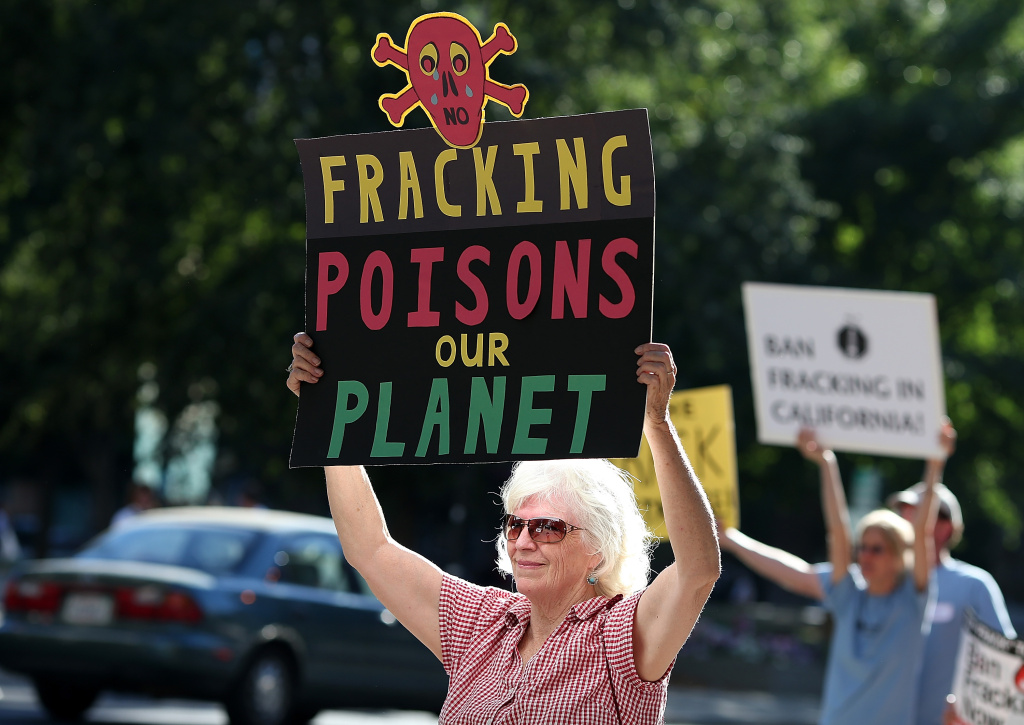 Protestors hold signs against fracking during a demonstration outside of the California Environmental Protection Agency (EPA) headquarters on July 25, 2012 in Sacramento, California. Dozens of environmental activists staged a