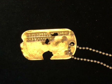The single dog tag in the 55 boxes of human remains turned over to the U.S. by North Korea last week was still readable. It was presented to Master Sgt. Charles Hobert McDaniel's two sons at a ceremony on Wednesday.