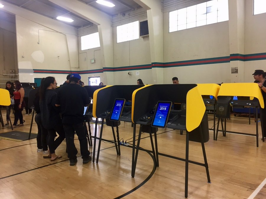 Voters try out touch-screen balloting during a mock election  at Salazar Park in East LA on Sept. 28, 2019.