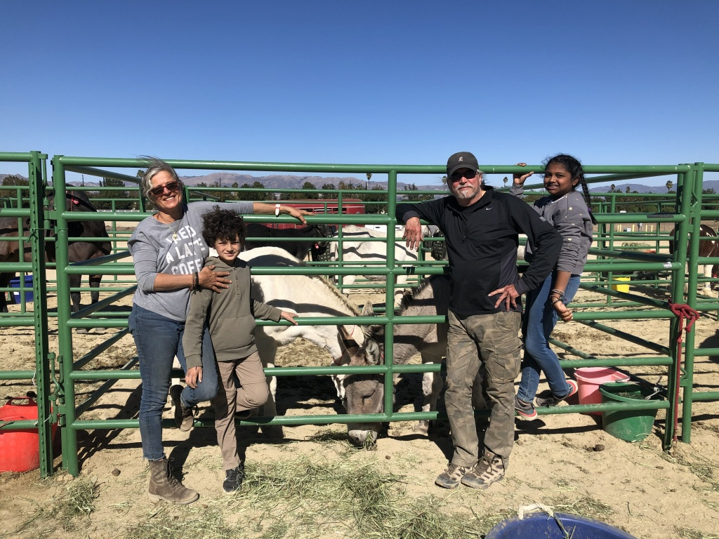 Isabelle Snyder (left) with her family and two of their donkeys at Pierce College where they sought shelter after the Woolsey fire evacuations.