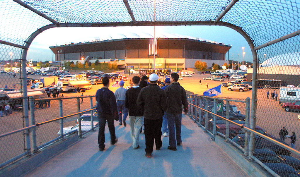 Fans walk into the Pontiac Silverdome in Pontiac, Michigan on October 8, 2001.