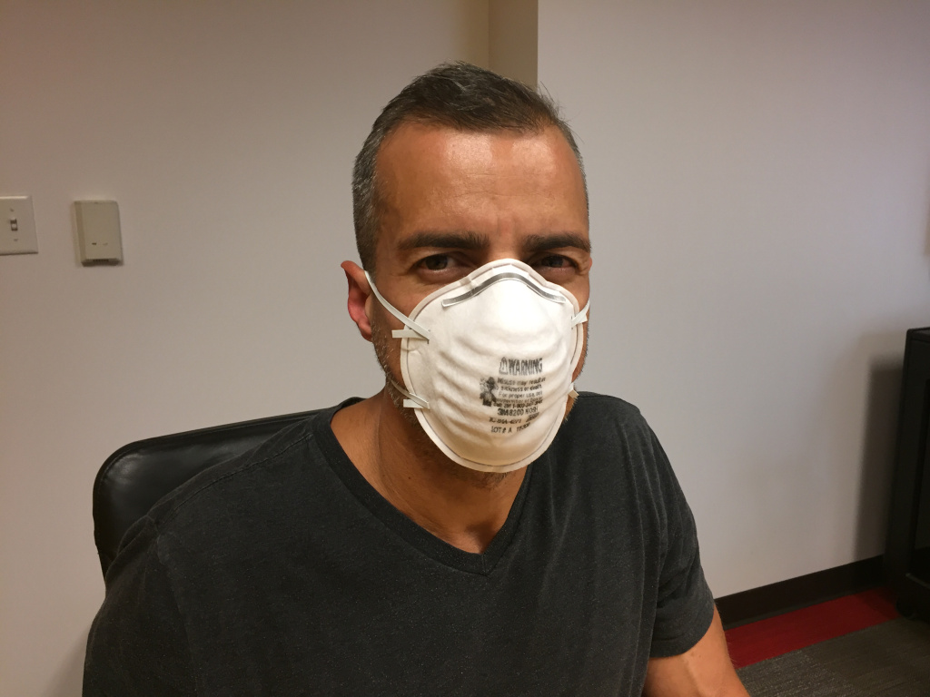 A Martinez tries on the standard N95 mask.