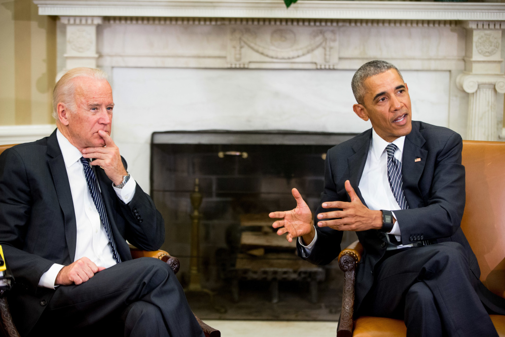 President Barack Obama, accompanied by Vice President Joe Biden, speaks to members of the media in the Oval Office at the White House in Washington, Friday, May 20, 2016, after receiving a briefing on the ongoing response to the Zika virus from members of his public health team.  (AP Photo/Andrew Harnik)