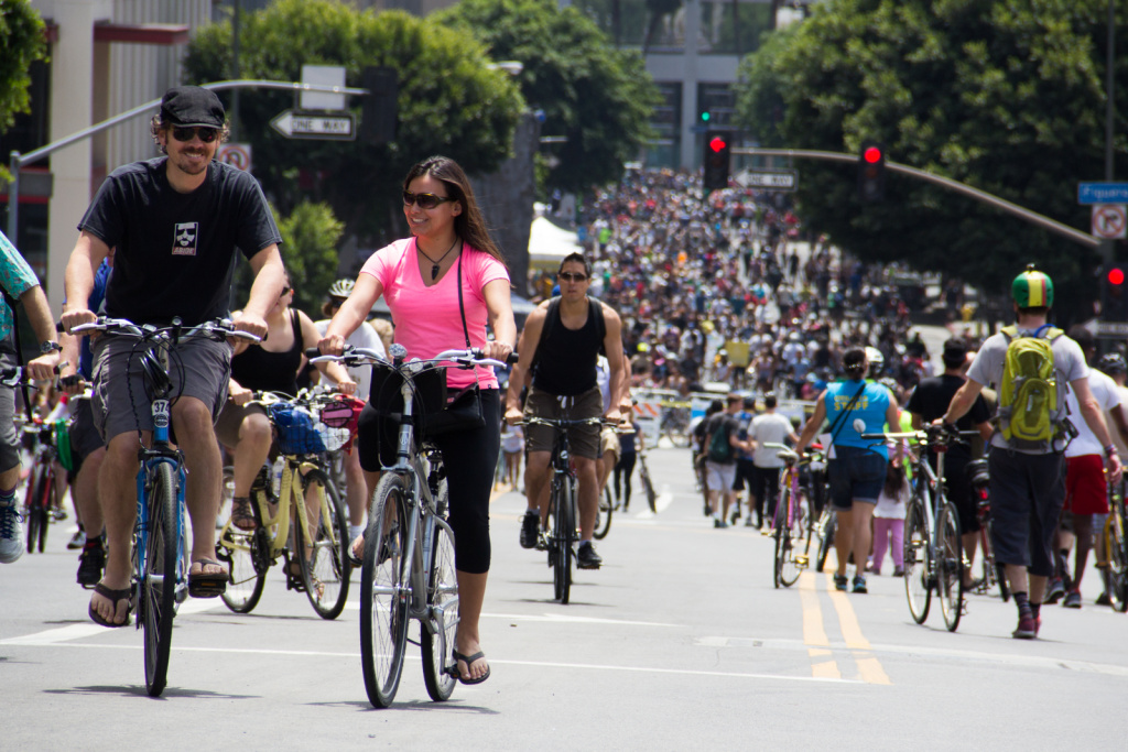 File: Riders climb Wilshire Boulevard in downtown L.A. during the seventh CicLAvia event on June 23, 2013.