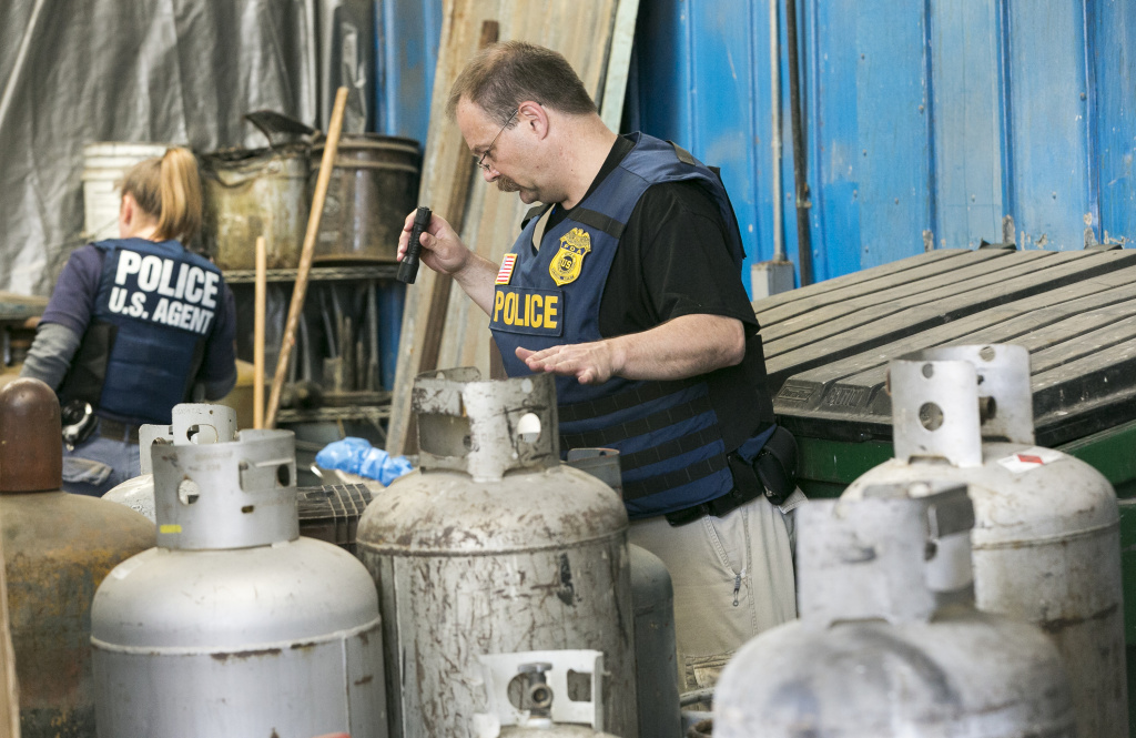 Agents with the Food and Drug Administration's Office of Criminal Investigations search for nitrous oxide tanks during a joint operation dubbed