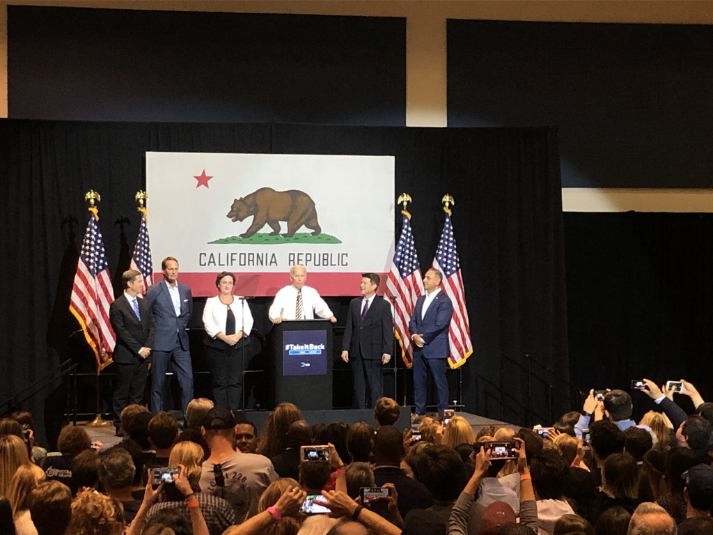 Former Vice President Joe Biden is flanked by California congressional candidates at a Democratic Party rally in Fullerton.