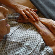 Hospice volunteers caress the hands of terminally ill patient Annabelle Martin, 92, as her health quickly declined at the Hospice of Saint John on September 1, 2009 in Lakewood, Colorado.