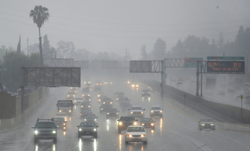 Commuters drive under heavy rainfall in Los Angeles on March 21, 2018.