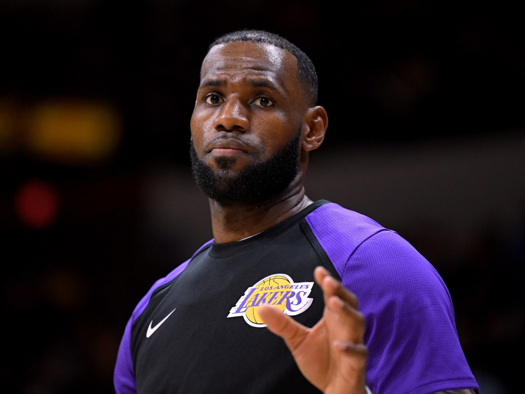 LeBron James #23 of the Los Angeles Lakers waits for the ball as he warms up before a preseason game against the Denver Nuggets