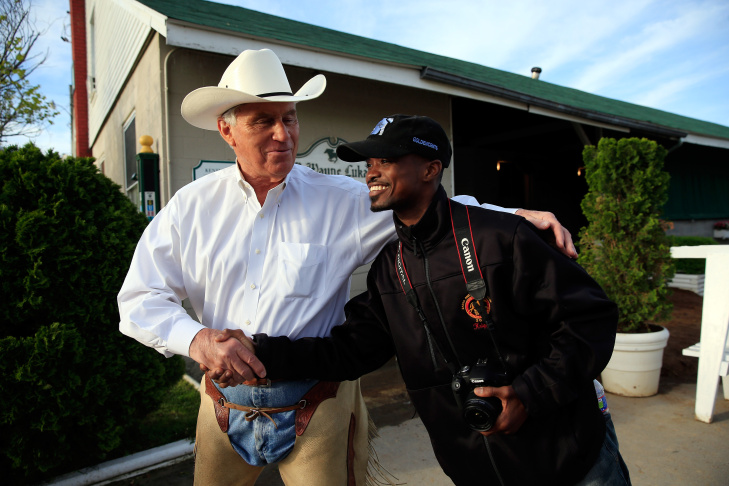 Jockey Kevin Krigger (R) shakes hands with trainer D. Wayne Lucas in front of his barn prior to the 2013 Kentucky Derby at Churchill Downs on May 2, 2013 in Louisville, Kentucky.