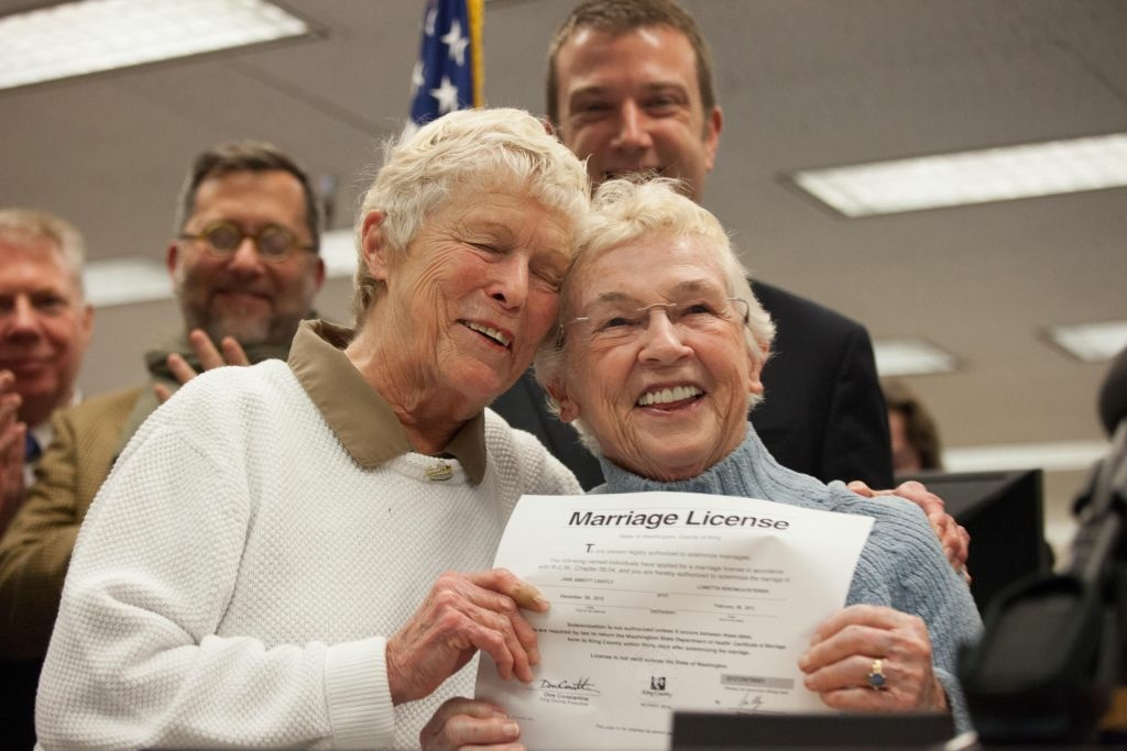 Jane Abbott Lighty, left, and Pete-e Petersen embrace after receiving the first same-sex marriage license in Washington state at the King County Recorder's Office on December 6, 2012 in Seattle, Washington.