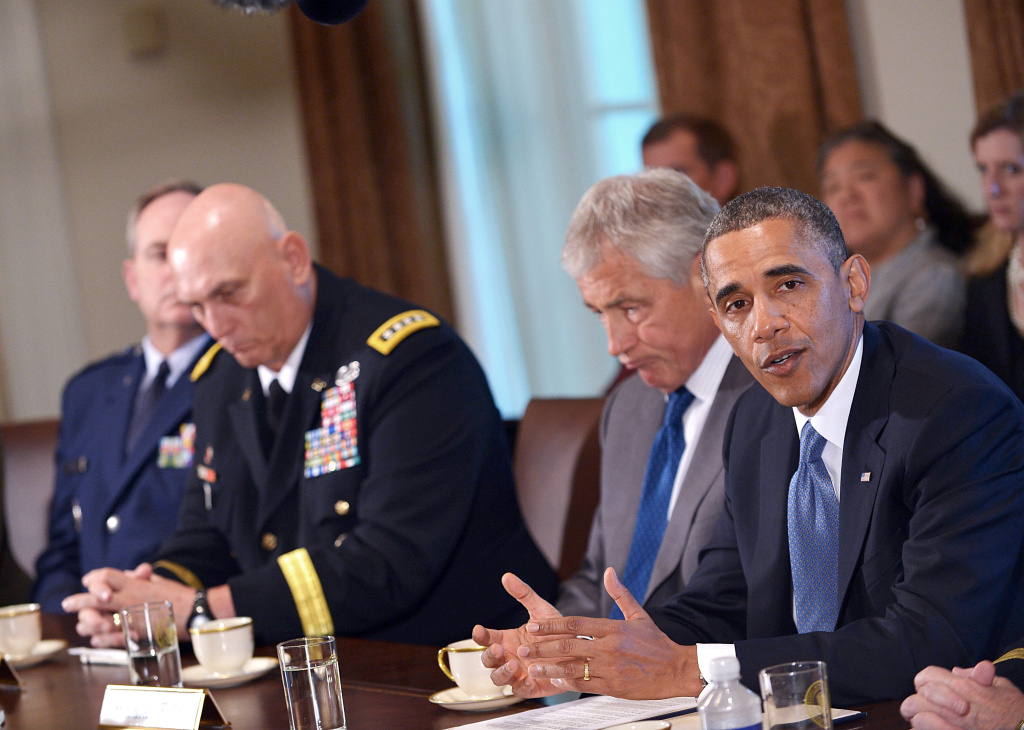 US President Barack Obama speaks following a meeting with US Defense Secretary Chuck Hagel (2nd R) and Chief of Staff of the Army Ray Odierno (2nd L) on 16 May, 2013 in the Cabinet Room of the White House in Washington, DC. Obama met with Hagel, service secretaries, and service chiefs to discuss sexual assault in the military. The US military vowed May 15 to address a wave of sexual assault cases after a soldier who worked in a rape prevention program was accused of forcing a subordinate into prostitution. The latest revelation marked the second time in a week that a member of the military assigned to work in its sexual assault prevention program had been placed under investigation for alleged sexual crimes.