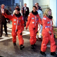 KENNEDY SPACE CENTER, FL - SEPTEMBER 12: Space Shuttle Endeavour crew members (L-R) Mamoru Mohri, Japan's first astronaut to fly on the space shuttle, Mae Jemison, the first African American woman in space and Jan Davis and Mark Lee, the first married couple to fly together, walk out of the Operations and Checkout Building at the Kennedy Space Center, FL, 12 September 1992. Endeavour is set to launch on a seven-day mission later in the day.