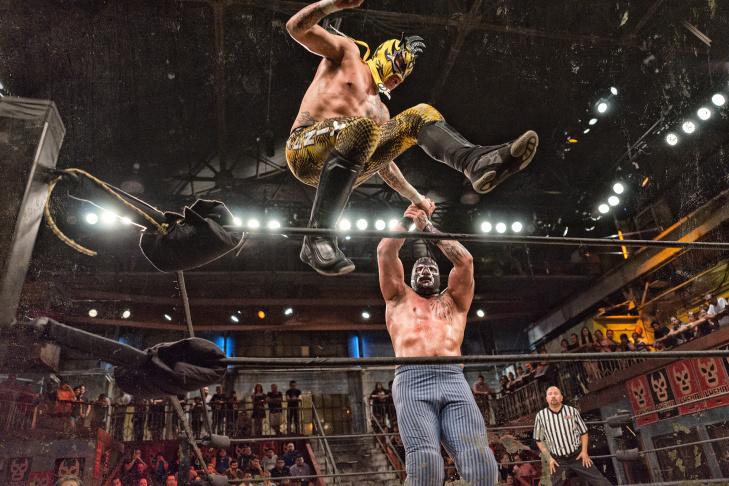 Rival luchadores, Drago (L) and King Cuerno (R), both veterans of Mexico's Asistencia Asesoría y Administración, or AAA.