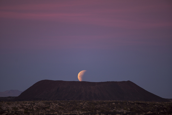 A so-called super blue blood moon is seen in total eclipse above the Mojave Desert on Jan. 31, 2018 near Amboy, California.