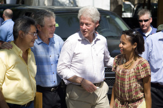 In this handout image provided by the United Nations Stabilization Mission in Haiti (MINUSTAH), Former U.S. Presidents, William Jefferson Clinton (2R) and George W. Bush (2L), speak to the owners of the Caribbean Crafts factory on March 22, 2010 in Port-au-Prince, Haiti. Former U.S. Presidents George W. Bush and Bill Clinton have been visiting Haiti as part of their fund-raising efforts to aid the earthquake-stricken nation. At least 220,000 people were killed and large parts of the capital, Port-au-Prince and other towns were leveled in the magnitude 7.0 quake.