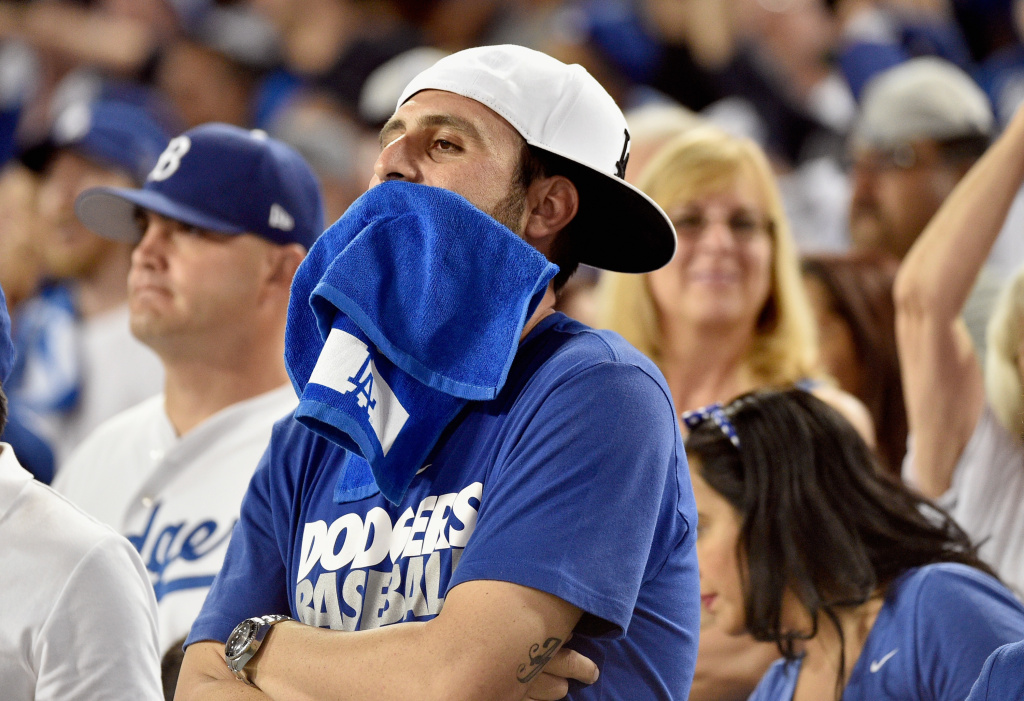A Los Angeles Dodgers fan reacts after the St. Louis Cardinals won Game One of the National League Division Series 10-9 at Dodger Stadium on October 3, 2014 in Los Angeles, California.