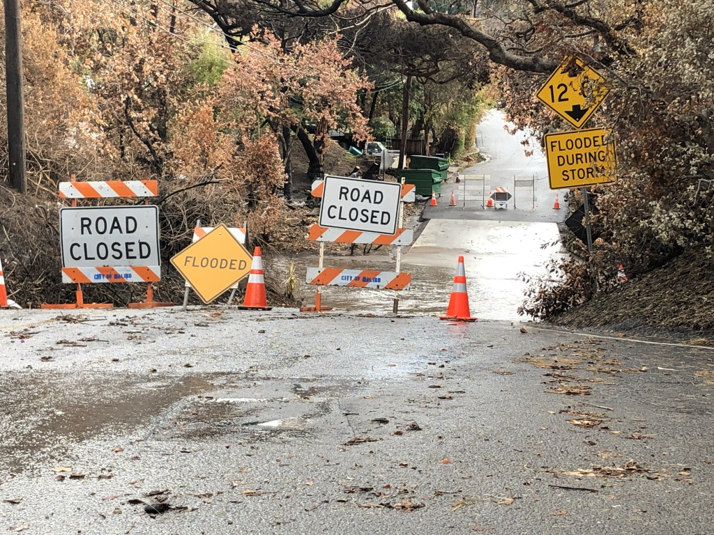 A residential street is underwater when four inches of rain flood Malibu in two days.