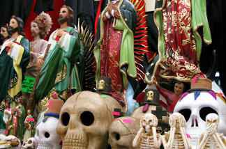 At the Sonora Market in Mexico City, statues of Christian icons are displayed for sale next to Day of the Dead figures and narco-saints. Increasingly, Mexicans are turning to amulets and figurines amid the country's brutal drug war and languishing economy.