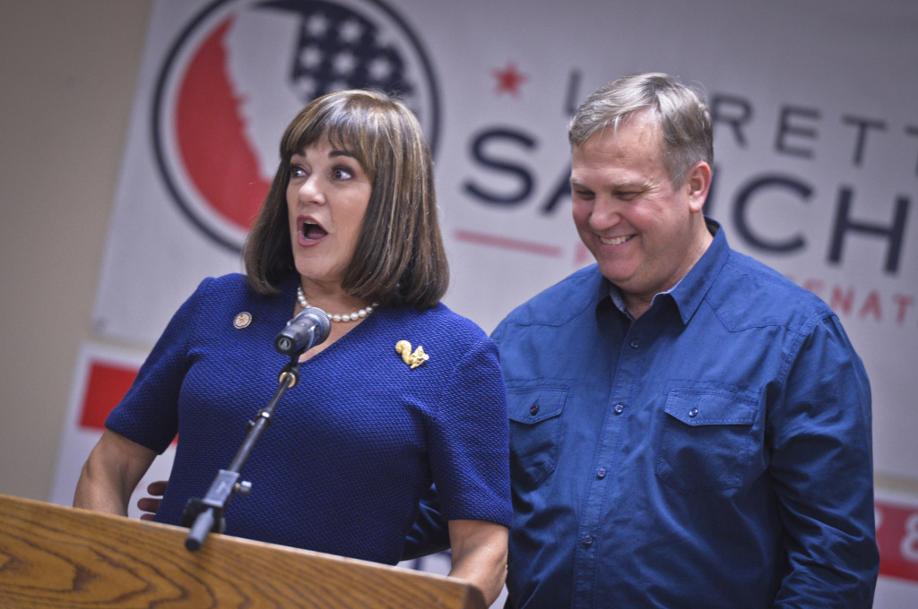 U.S. Senate candidate Loretta Sanchez speaks Tuesday evening to supporters at the campaign's election headquarters in Santa Ana. To the right is Sanchez's husband, Jack Einwechter.