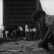 "Kids playing by the train in the film ""Killer of Sheep;"" a Milestone Film & Video release."