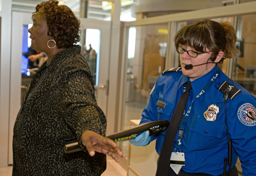 A passengers is checked by a Transportation Security Administration (TSA) officer at Baltimore-Washington International Airport's security screening checkpoint on April 28, 2008 in Linthicum, Maryland.