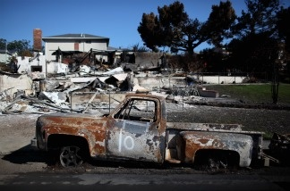 The shell of a truck sits in front of a burned home near the epicenter of the gas line explosion that devastated a neighborhood near San Francisco International Airport on Sept. 24, 2010 in San Bruno, Calif.