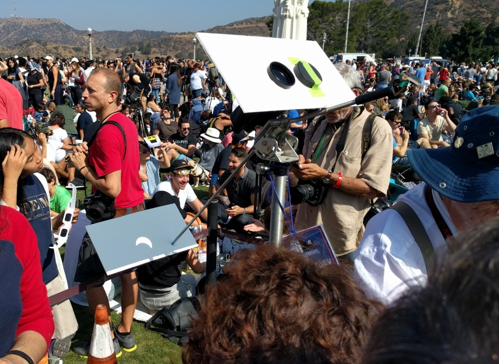The Observatory set-up different viewers of the eclipse for those without glasses. This one trains a set of binoculars onto a sheet of paper