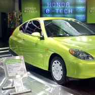A man looks at a prototype of Honda's new hybrid c