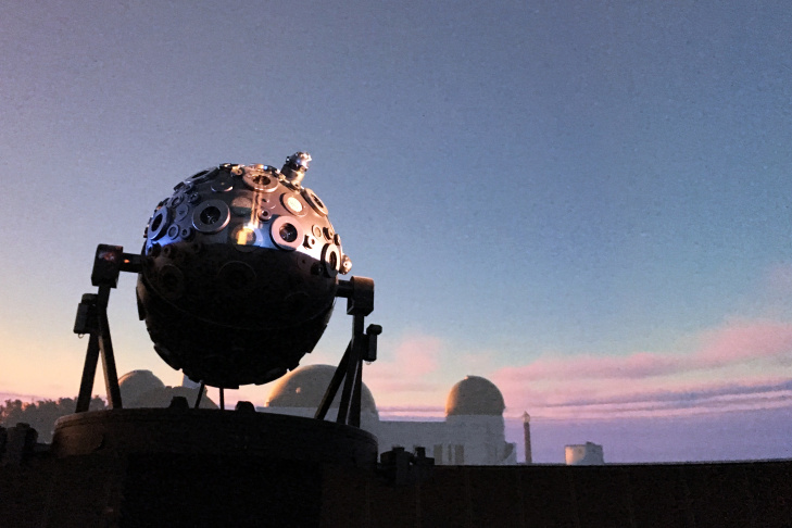 The Zeiss star projector at Griffith Observatory stands inside the planetarium. An image of the Observatory at sunset is projected in the dome using all new digital projectors.