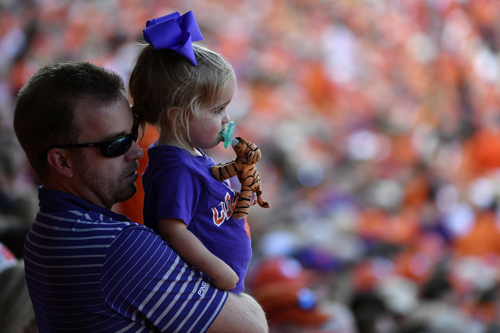 A father holds a young Clemson Tigers fan during the Tigers' game against the Wake Forest Demon Deacons at Memorial Stadium on October 7, 2017 in Clemson, South Carolina.