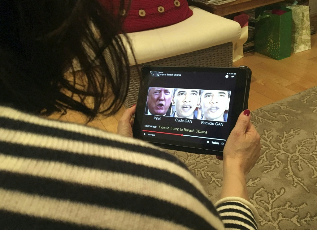 A woman in Washington, DC, views a manipulated video on January 24, 2019, that changes what is said by President Donald Trump and former president Barack Obama.