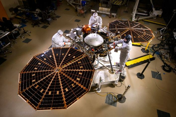 The solar arrays on NASA's InSight lander are deployed in this test inside a clean room at Lockheed Martin Space Systems, Denver. This configuration is how the spacecraft will look on the surface of Mars.