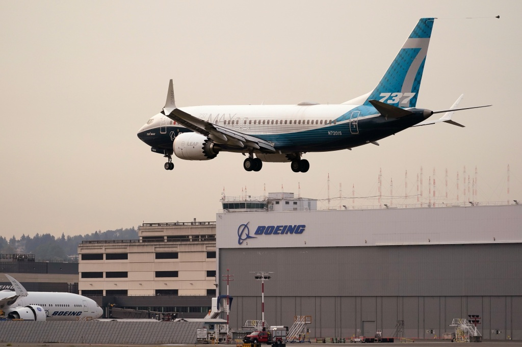 A Boeing 737 MAX jet, piloted by Federal Aviation Administration chief Stephen Dickson, prepares to land at Boeing Field following a test flight late September in Seattle.