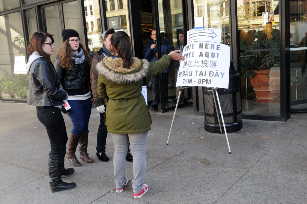 A volunteer helps young voters outside the Boston Public Library November 6, 2012 in Boston, Massachusetts.