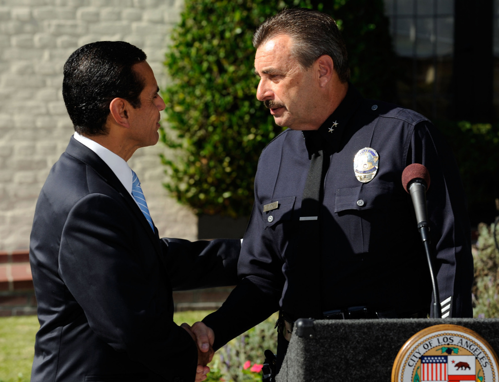 Los Angeles Mayor Antonio Villaraigosa (L) congratulates Los Angeles Police Department Deputy Chief Charles Beck after he was announced as the mayor's selection to be the new Chief of Police at a news conference at the Getty House, the official residence of the mayor, on Nov. 3, 2009 in Los Angeles.