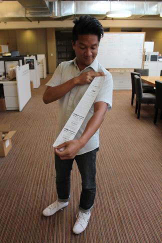 Take Two producer Leo Duran shows his long CVS receipt.