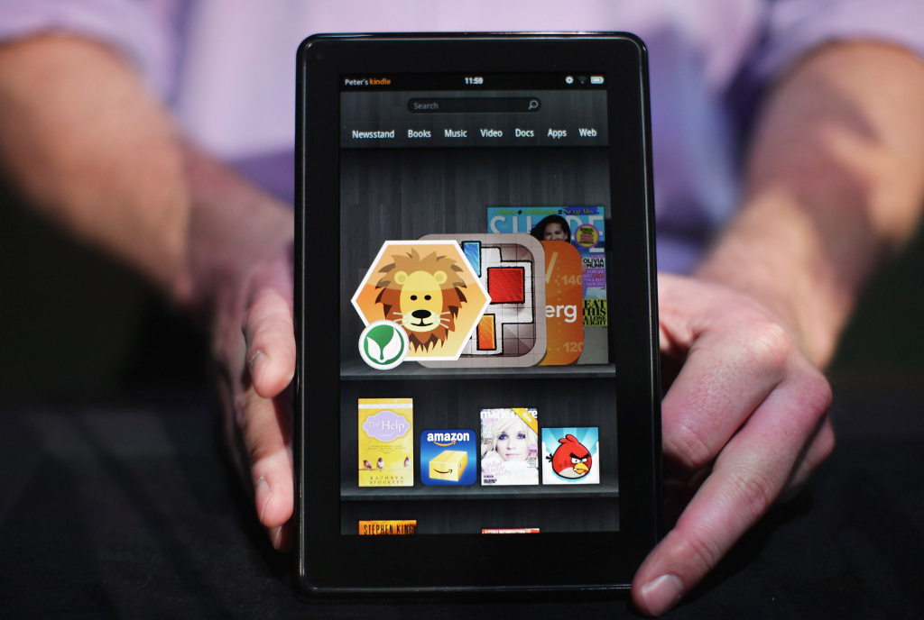 The new Amazon tablet called the Kindle Fire is displayed on September 28, 2011 in New York City. Such digital ventures embarked by Amazon have made the company an inadvertent threat to the book publishing industry.