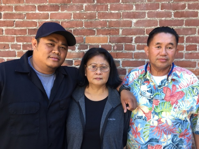 The family of a Mharloun Saycon, a man shot and killed by Long Beach Police officers, is filing a claim against the department. Pictured from left to right: brother, Khanly Saycon II, mother, Anna Luz Saycon, and father, Khanly Saycon, Jr.