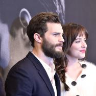 "Actors Jamie Dornan (L) and Dakota Johnson attend the ""Fifty Shades Of Grey"" New York Fan First screening at Ziegfeld Theatre on February 6, 2015 in New York City."