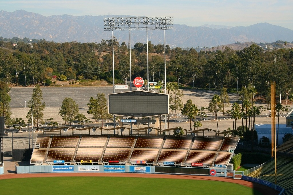 The bleachers stand empty at Dodger Stadium in Los Angeles, California. You can see Frank McCourt's precious parking lots in the background.