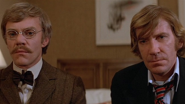 Malcolm McDowell and David Warner in