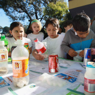 School children at Fairmount Elementary School look at a display showing how much sugar is in soft drinks and juices on November 12, 2010 in San Francisco, California.
