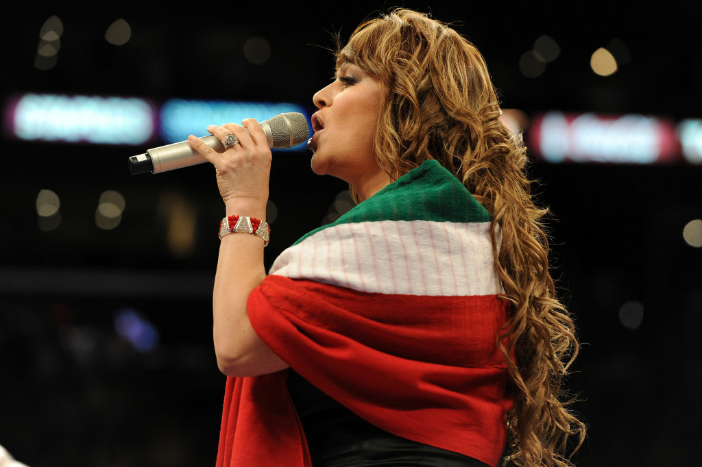 Jenny Rivera sings the Mexican national anthem before the Middleweight bout against Shane Mosley and Sergio Mora at Staples Center on September 18, 2010 in Los Angeles, California.