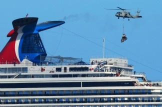 A Navy HH-60H Sea Hawk helicopter from the aircraft carrier USS Ronald Reagan delivers pallets of supplies to the Carnival cruise ship C/V Splendor November 9, 2010 off the coast California.