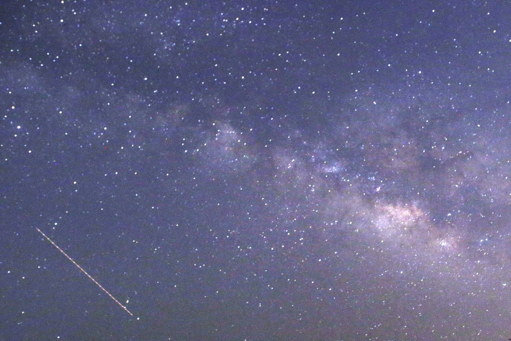 This long-exposure photograph taken on April 23, 2015 on Earth Day shows Lyrids meteors shower passing near the Milky Way in the clear night sky of Thanlyin, nearly 14miles away from Yangon.