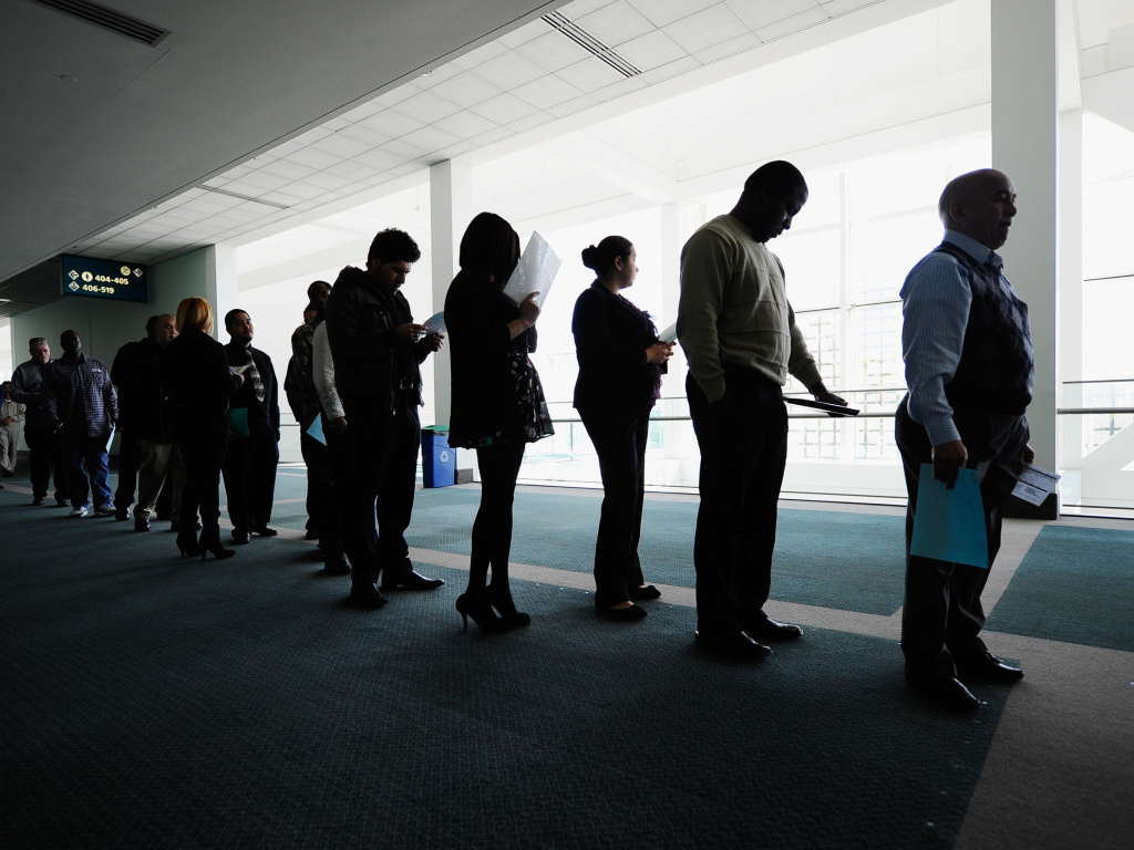 Job seekers line up to enter a career fair in Los Angeles, on Dec. 1, 2010. At the peak of the recession, the unemployment rate hit 10 percent. It's now 4.1 percent.
